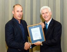 Jason reciving award from MP Tim Macindoe